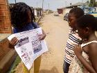Female Project Officer creating awareness on drowning in Ghana