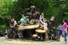Children-play-on-alice-in-wonderland-sculpture-central-park-new-york-3