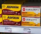 Bayer Aspirin and store-brand generic on Canadian drugstore shelf